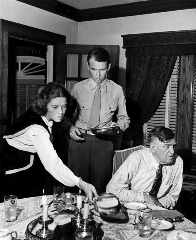 Jimmy Stewart clearing the table, 1945