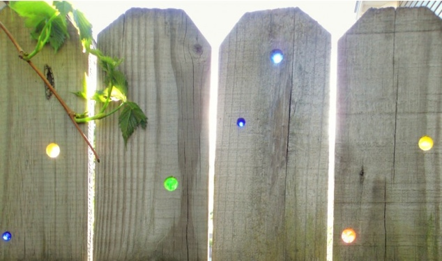 glass marbles in fence holes