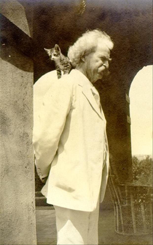 Mark Twain with Cat on His Shoulder
