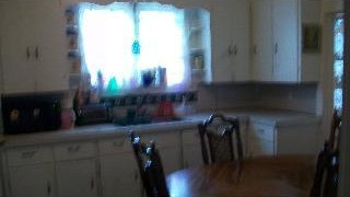 Extremely blurry picture of a kitchen