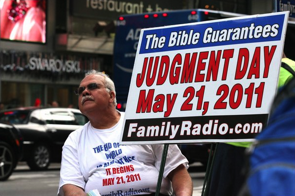 A man sits in New York with a sign warning people that Judgment day will happen on May 21, 2011.