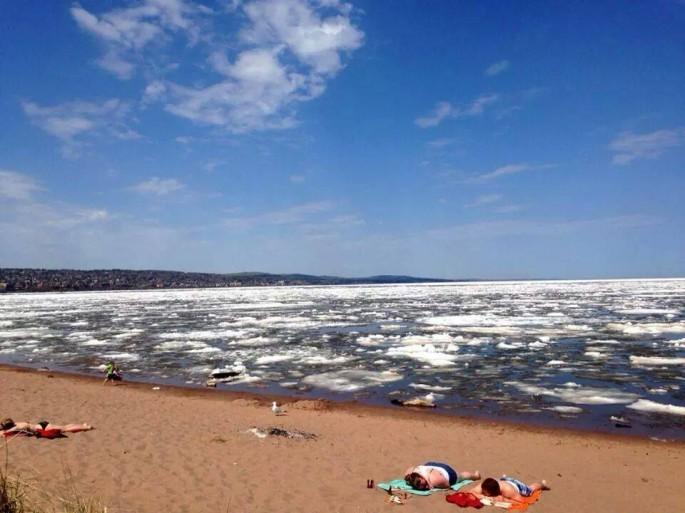 Sunbathers by ice-filled Lake Superior - 01