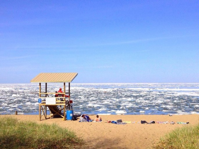 Sunbathers by ice-filled Lake Superior - 02