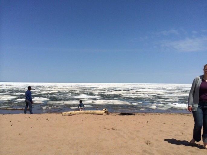 Sunbathers by ice-filled Lake Superior - 03